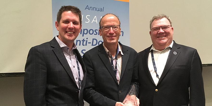 2018 LD Bowers Award winner Dr. Matthias Kamber (center)