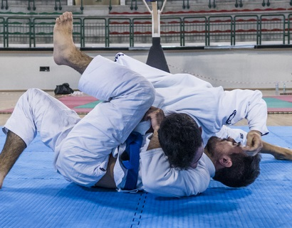 Two Brazilian Jiu-Jitsu athletes competing
