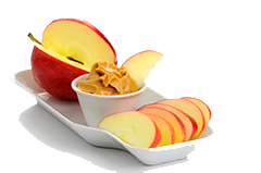 apples and peanut butter on white background
