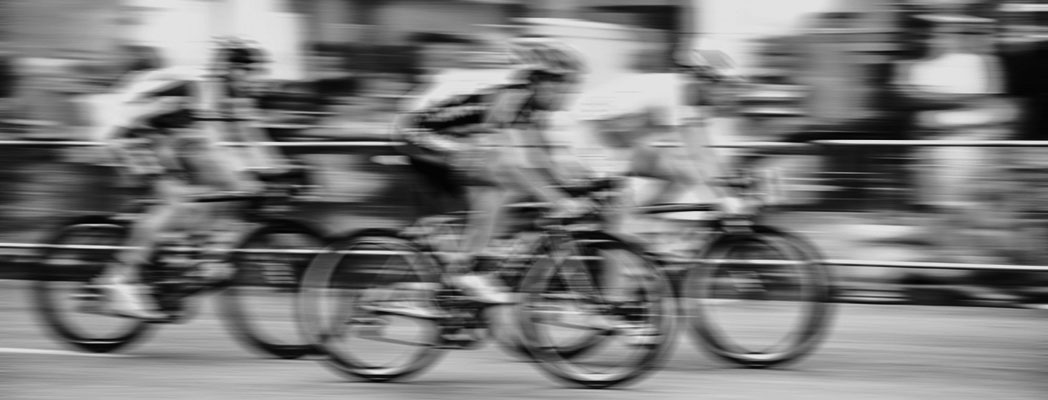blurred-cyclist-black-and-white