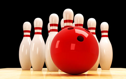 bowling ball in front of pins