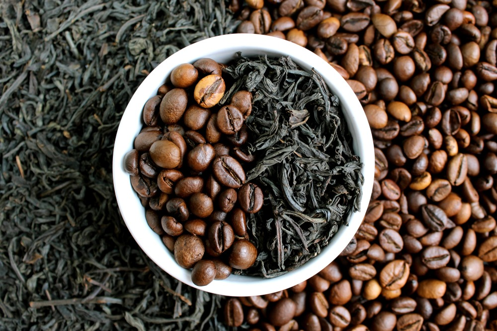 Bowl of coffee beans and tea leaves.