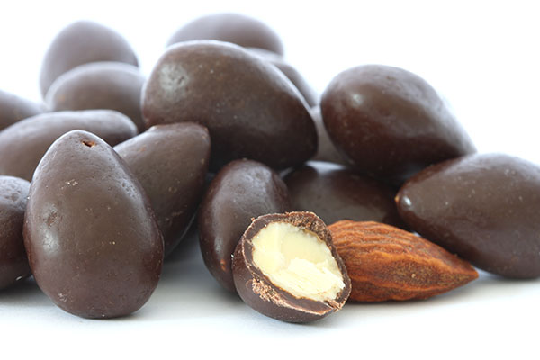 Close up of dark chocolate covered almonds.