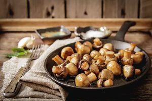 Cooked mushrooms in a pan.