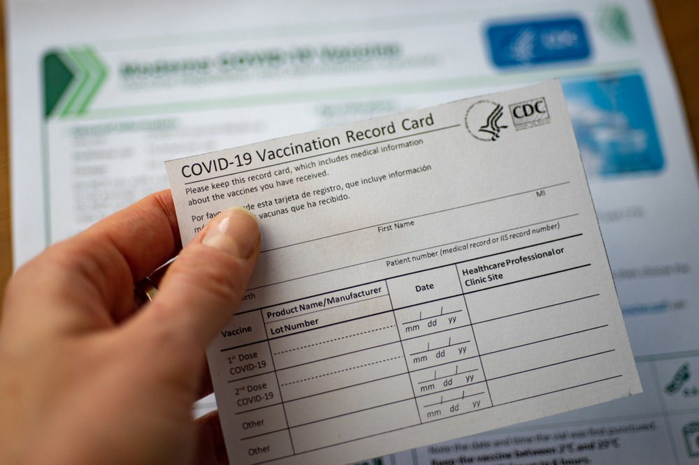 Close up of a CDC COVID-19 vaccination report card.