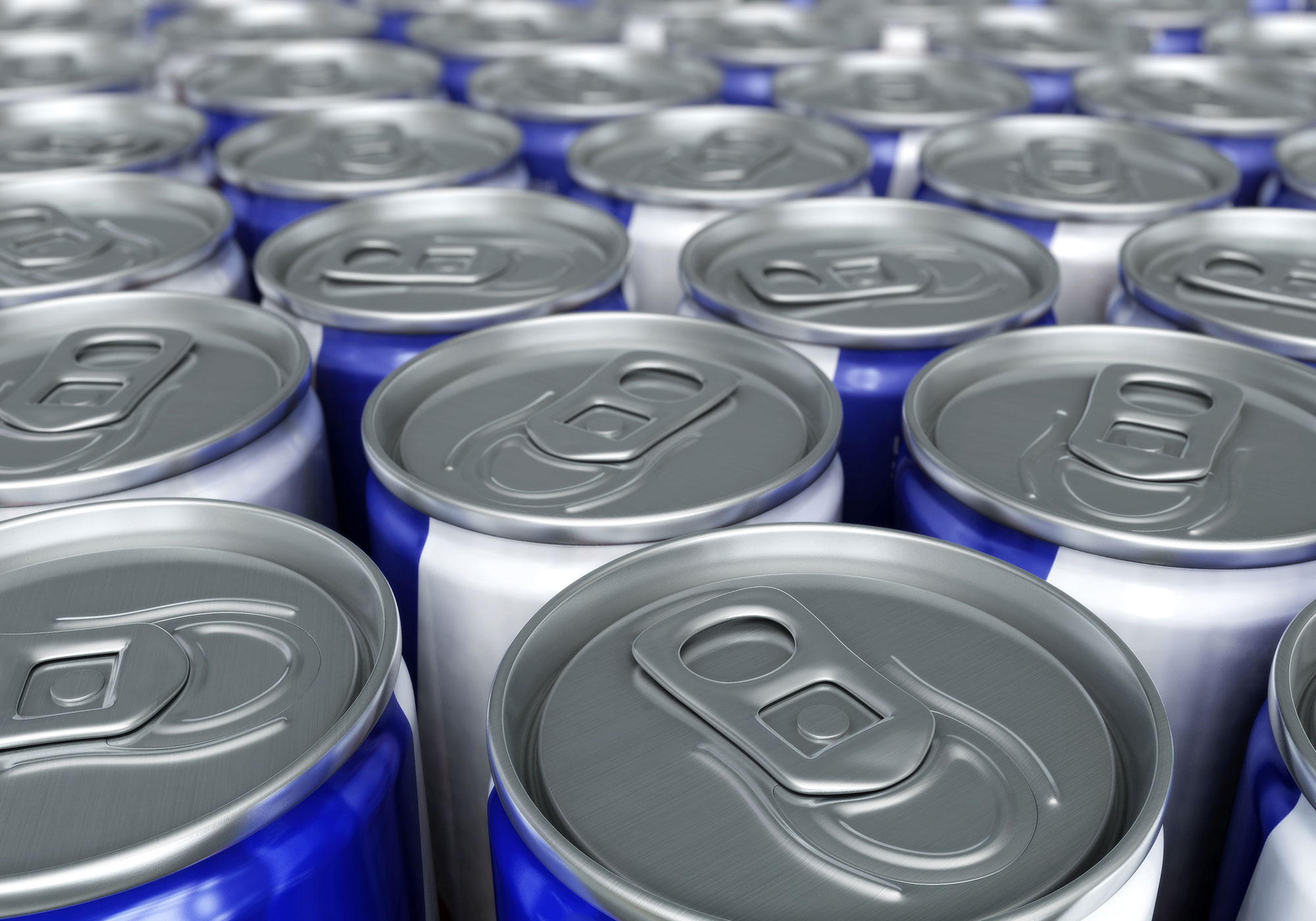 overhead shot of many cans of energy drinks
