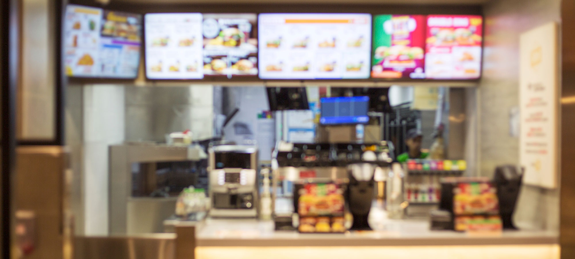 Blurred out image of the inside of a fast food restaurant.