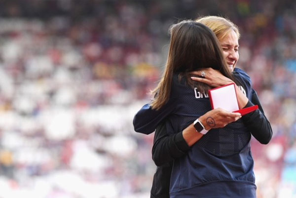 Kara Goucher receiving a medal