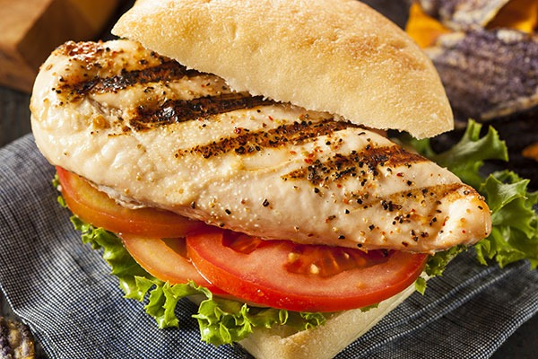 Grilled chicken sandwich with lettuce and tomato