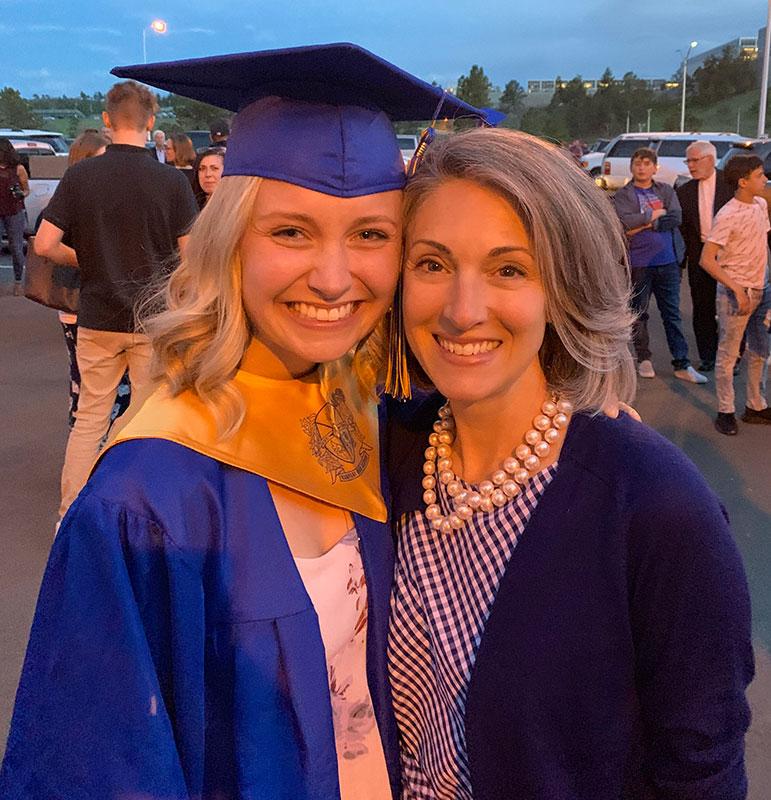 Jen Royer next to her high school graduate mentee