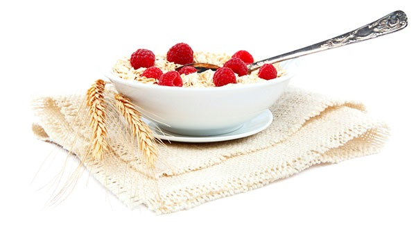 bowl of oatmeal with fruit on white background