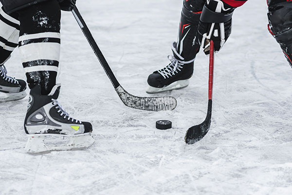 close-up of hockey players feet as they face off