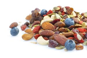 pile of trail mix made of nuts and berries
