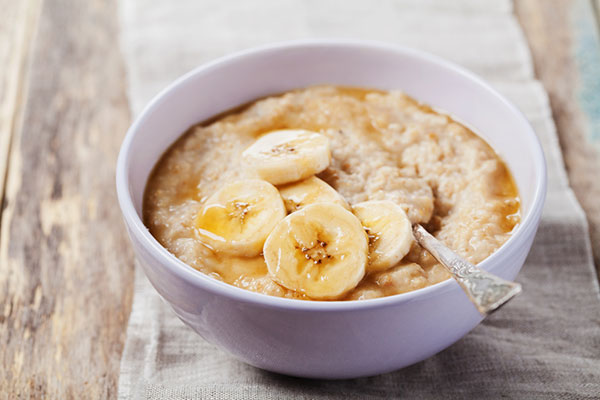 bowl of oatmeal with sliced banana