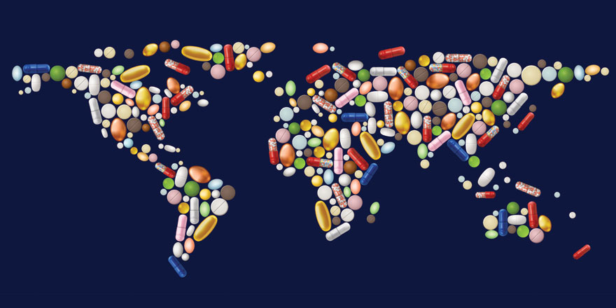 multi-colored pills in shape of world map on blue background