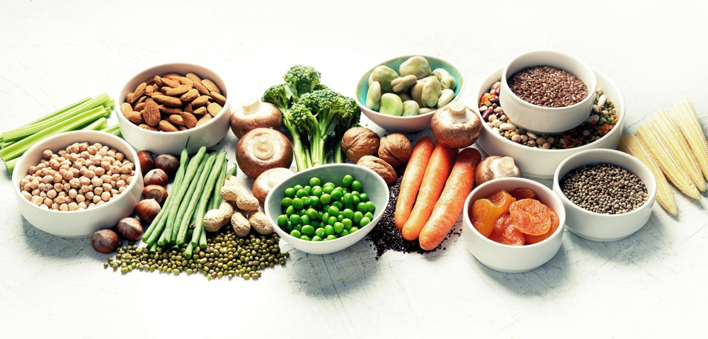 Variety of plant-based foods on a white background.