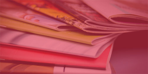 publications laying on table with red overlay