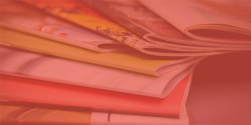 stack of publications with red overlay
