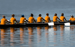 a rowing team training on the water