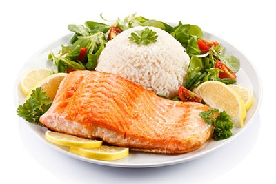 grilled salmon with rice and vegetables on a plate