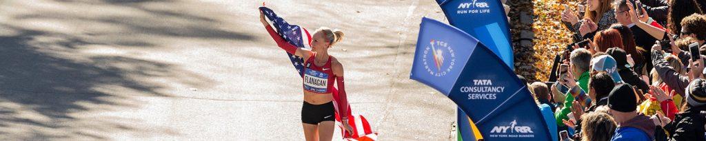 Shalane Flanagan holding USA flag
