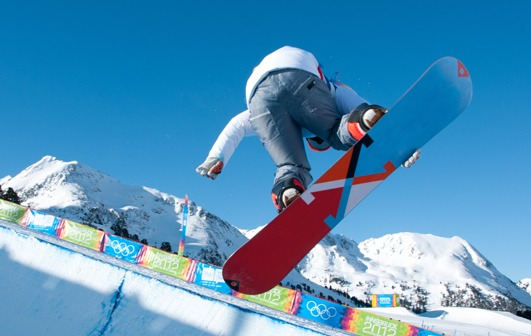 snowboarder in mid-air over half pipe