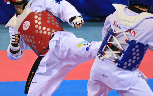 Two athletes competing in taekwondo
