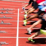 track and field athletes immediately after leaving the start line in a race
