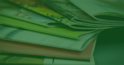 pile of publications with green overlay