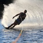 man waterskiing and creating a splash