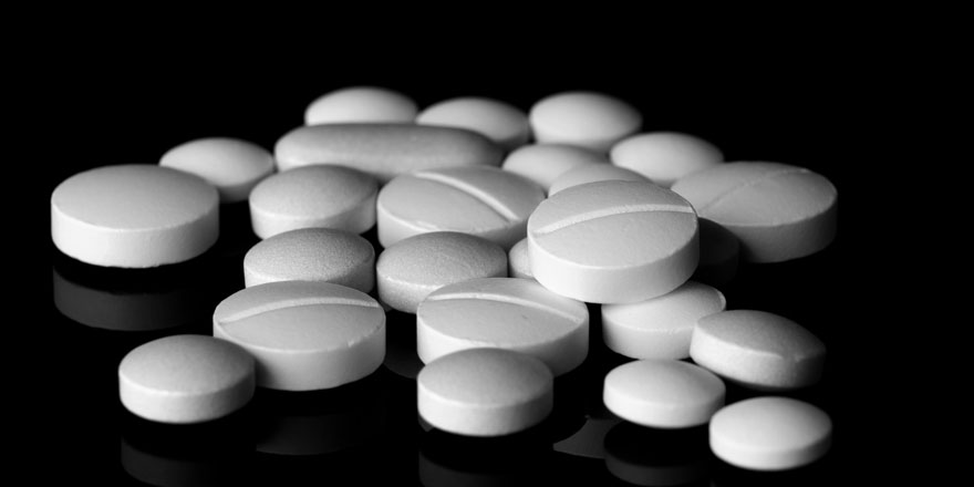 white pills on black background