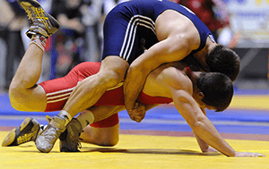 two male wrestlers in the middle of a match